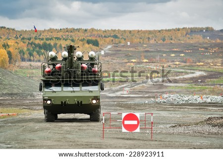 Nizhniy Tagil, Russia - September 26. 2013: Bouck M2 complex placed on wheel drive truck MZKT-69221 Medium-range surface-to-air missile systems on demonstration range. Russia Arms Expo-2013 - stock photo