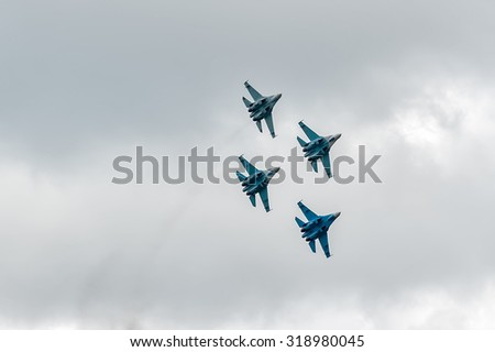 Nizhniy Tagil, Russia - September 25. 2013: fighters SU-27 display of fighting opportunities of equipment with application of aviation means of defeat. RAE-2013 exhibition (Russia Arms Expo-2013) - stock photo