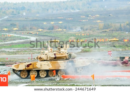 Nizhniy Tagil, Russia - September 25. 2013: Modernized tank T-90S moves after overcoming of water of 1.5 meters in depth. Russia Arms Expo (RAE)-2013 exhibition - stock photo