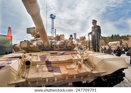 Nizhniy Tagil, Russia - September 25. 2013: Officer of foreign army studies tank T-72. Modernized tank. RAE-2013 exhibition (Russian Arms Expo) - stock photo