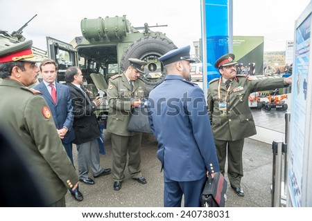 Nizhniy Tagil, Russia - September 25. 2013: Officers of foreign army get acquainted with materials on armored vehicle. RAE-2013 exhibition (Russian Arms Expo)
