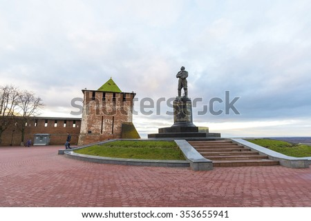 Nizhny Novgorod, Russia - November 11 2015. View of the Kremlin's St. George Tower and a monument to the pilot Chkalov