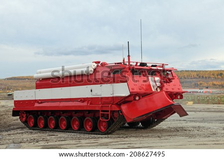 NIZHNY TAGIL, RUSSIA - SEP 26, 2013: The international exhibition of armament, military equipment and ammunition RUSSIA ARMS EXPO (RAE-2013). Caterpillar fire truck to extinguish forest fires