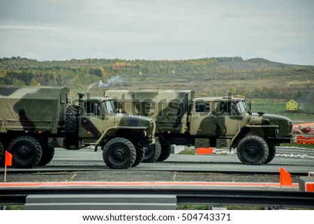 Nizhny Tagil, Russia - Sept 11, 2015: 10 Russia Arms Expo. Demonstration of military equipment. Auxiliary equipment. Trucks are an obstacle