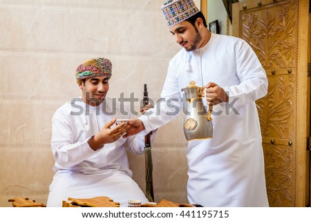 NIZWA, OMAN, MAY 27, 2016: two Omani men having traditional Omani coffee