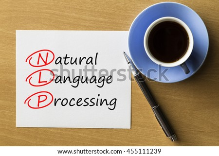 NLP Natural Language Processing - handwriting on paper with cup of coffee and pen, acronym business concept