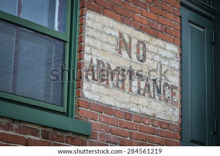 No Admittance Sign On Brickwall Close Up - stock photo