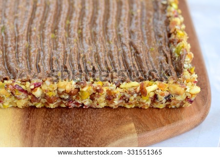 no bake chocolate avocado pudding with date almond raisin pistachio pie crust  - stock photo
