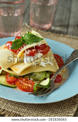 No-bake vegetarian lasagna with tomatoes, zucchini, cream cheese and parmesan - stock photo