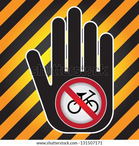 No Bicycle Prohibited Sign Present By Hand With No Bicycle Sign Inside in Caution Zone Dark and Yellow Background - stock photo