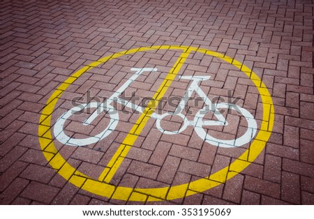 No bicycles symbol with a brick background - stock photo