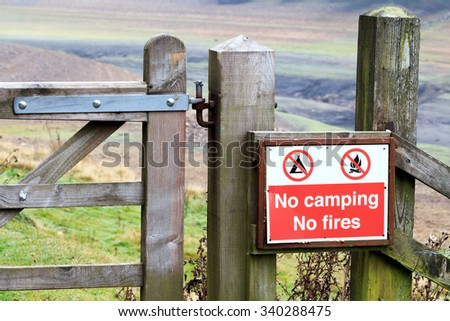No camping, no fires warning sign