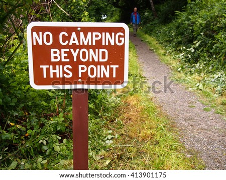 No camping restriction sign at a public park.