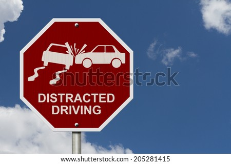 No Distracted Driving Sign, Red stop sign with words Distracted Driving and accident icon with sky background - stock photo