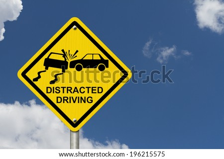 No Distracted Driving Sign, Yellow warning sign with words Distracted Driving and accident icon with sky background - stock photo