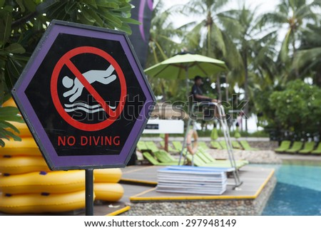 No diving sign on the side of a swimming pool in Pattaya, Thailand. - stock photo