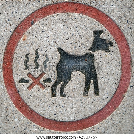 No dog fouling sign, set in a stone paving slab. - stock photo