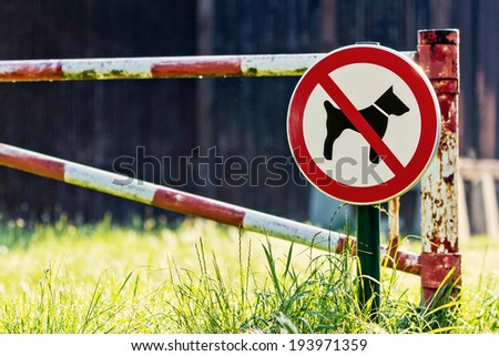 No Dogs Allowed Sign by an Old Ramp - stock photo