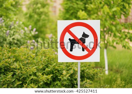 No dogs allowed sign in the park