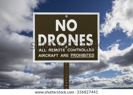 No drones sign with gathering storm clouds - stock photo