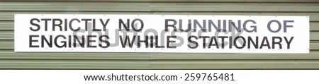 No engines running are allowed when a vehicle is stationary sign. - stock photo