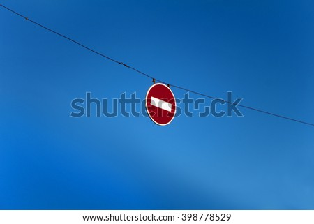 No entry for vehicles traffic sign against blue sky - stock photo