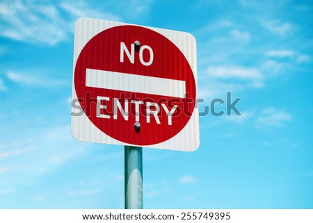 No Entry road sign with blue sky  - stock photo
