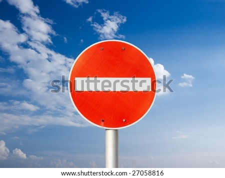 No entry traffic sign against blue sky - stock photo