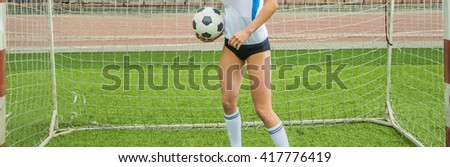 no face. sexy Goalkeeper woman before a penalty kick. Empty stadium and blue sky with clouds on background. Unrecognizable person. Space for inscription or objects.  - stock photo