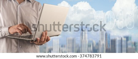 No face, unrecognizable business man person Young businessman using laptop and look to 2016 year text with blue sky and cloud in the background. - stock photo