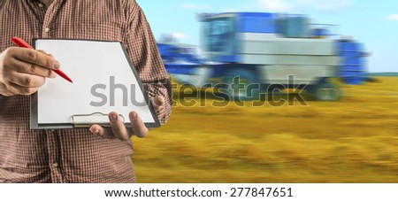 No face Unrecognizable person Businessman hold empty list of paper red pen Business man wear brown shirt Copy space for inscription Experienced agronomist examining wheat grain in field Takes readings - stock photo