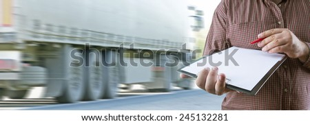No face Unrecognizable person Businessman holding white texture empty list of paper document and red pen Business man wearing stripped brown shirt Copy space for inscription Truck Delivery metaphor - stock photo