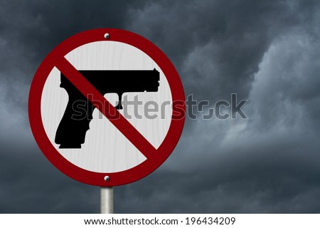 No Firearms Allowed Sign, An red road sign with handgun icon and not symbol with stormy sky background - stock photo