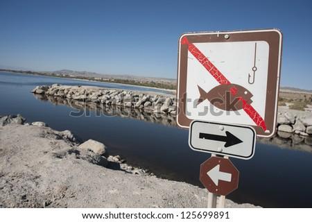 No fishing sign at the Salton sea - stock photo