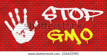 no gmo stop genetic manipulated organisms or food engineering graffiti on red brick wall, text and hand - stock photo