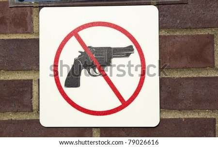 No guns permitted - sign saw on the wall - stock photo