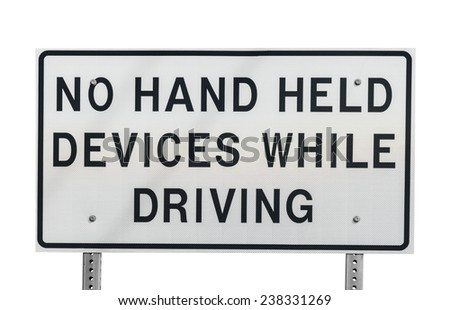 No hand held devices while driving sign isolated with clipping path. - stock photo
