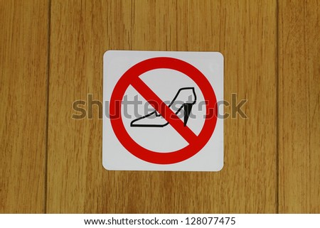 No high heels sign on wooden floor