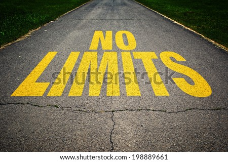 No Limits message on asphalt road. Concept of safe driving, road safety and preventing traffic accident. - stock photo