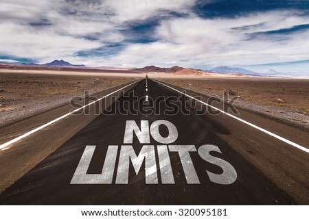 No Limits written on desert road - stock photo