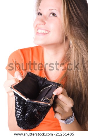 No money in a purse. Young woman isolated on white. - stock photo