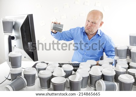 No more coffee for tired and sad businessman - stock photo