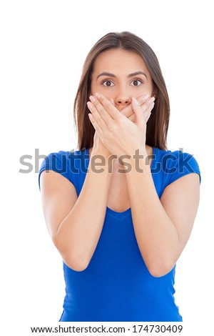 No more word. Shocked young woman covering mouth with hands while standing isolated on white - stock photo