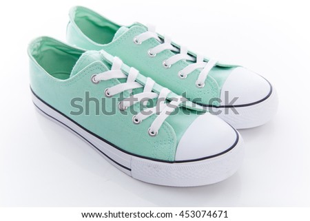 no name green cyan classic sneakers with white laces on a white rubber sole on white background