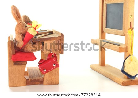 No name plush toy with Conical Bag of Sweets for the first school day in the classroom - stock photo