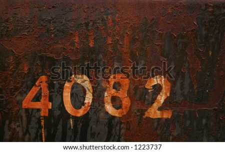 No 4082 on black/brown rusted background. - stock photo