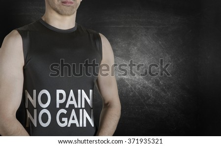 No pain no gain. Conceptual image of healthy life. Caucasian male fit model on black background. - stock photo