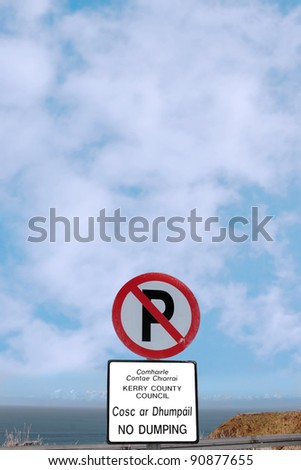 no parking and no dumping sign on a cliff edge in ballybunion county kerry ireland - stock photo
