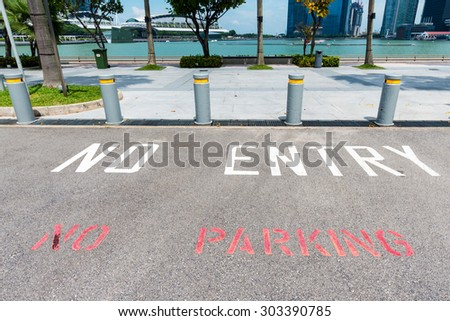 No Parking and No entry sign painted on asphalt in a park - stock photo