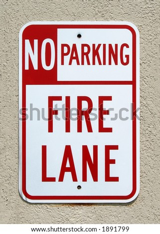 No Parking Fire Lane sign on a stucco wall